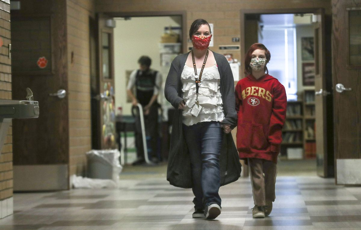 RayShell Shelden, a paraeducator who works with special education students at Philo T. Farnsworth Elementary School in West Valley City, walks with her fourth grade daughter, Karma, as they head home after school on Tuesday, Feb. 23, 2021.