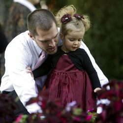 Lance Archibald looks at the flowers with his daughter Aria during the Saturday morning session of General conference Saturday, Oct. 6, 2012.