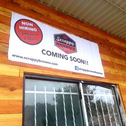 Coming soon sign at Scrappy Brown's.