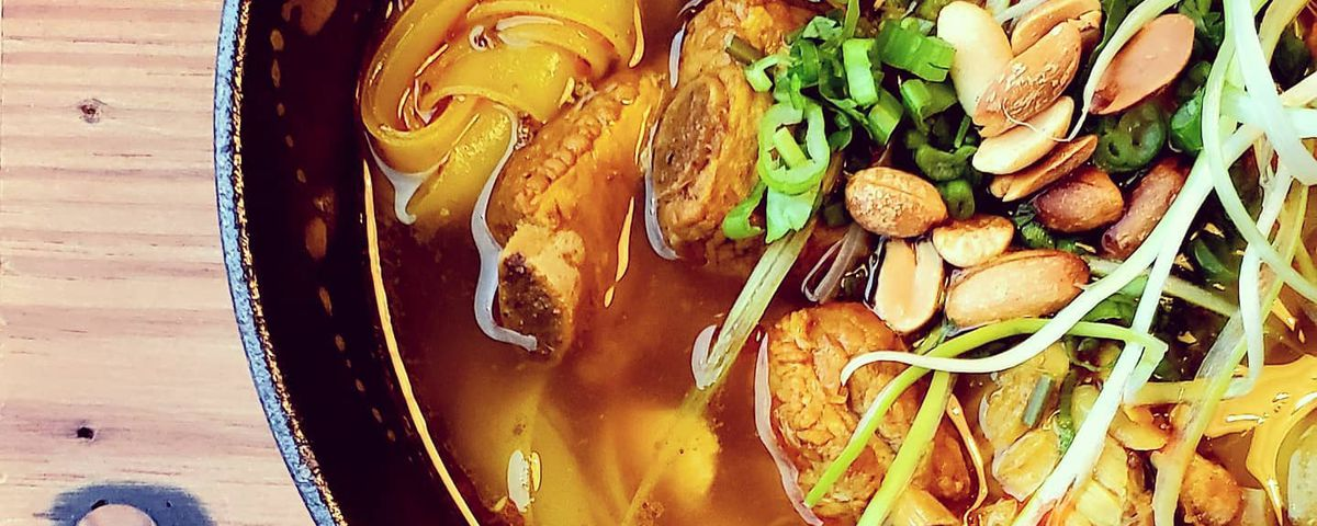"""Mi Quang"""", a classic Vietnameseegg noodlebowl with spare ribs, chicken, quail egg, shrimp and in a savory broth"""