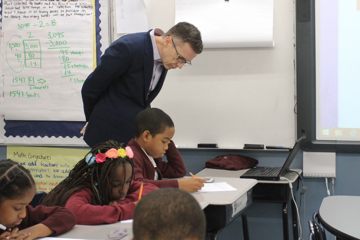 Ascend charter school network CEO Steve Wilson observes students in a fourth-grade English class in 2016.
