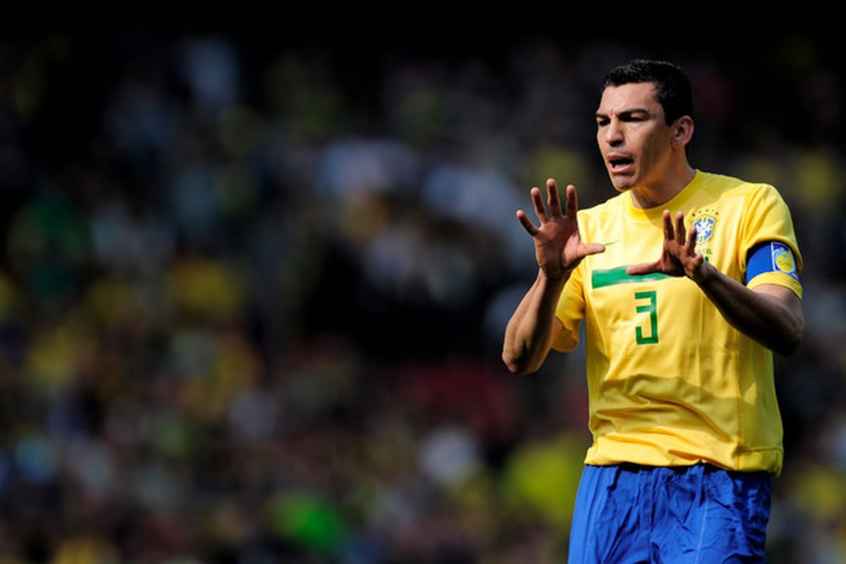 LONDON, ENGLAND - MARCH 27: Captain Lucio of Brazil gestures during the International friendly match between Brazil and Scotland at Emirates Stadium on March 27, 2011 in London, England.  (Photo by Jamie McDonald/Getty Images)