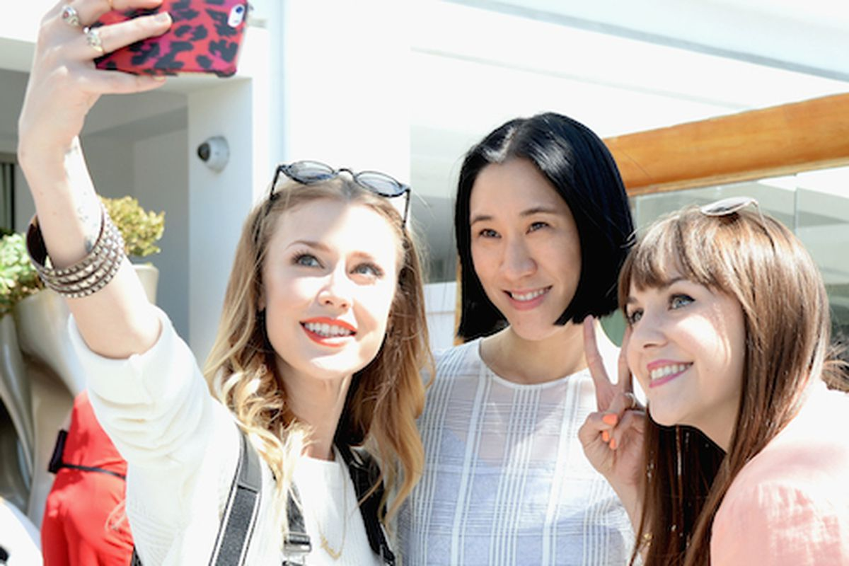 Eva Chen posing with guests at Lucky's LA FABB conference. Image via Getty