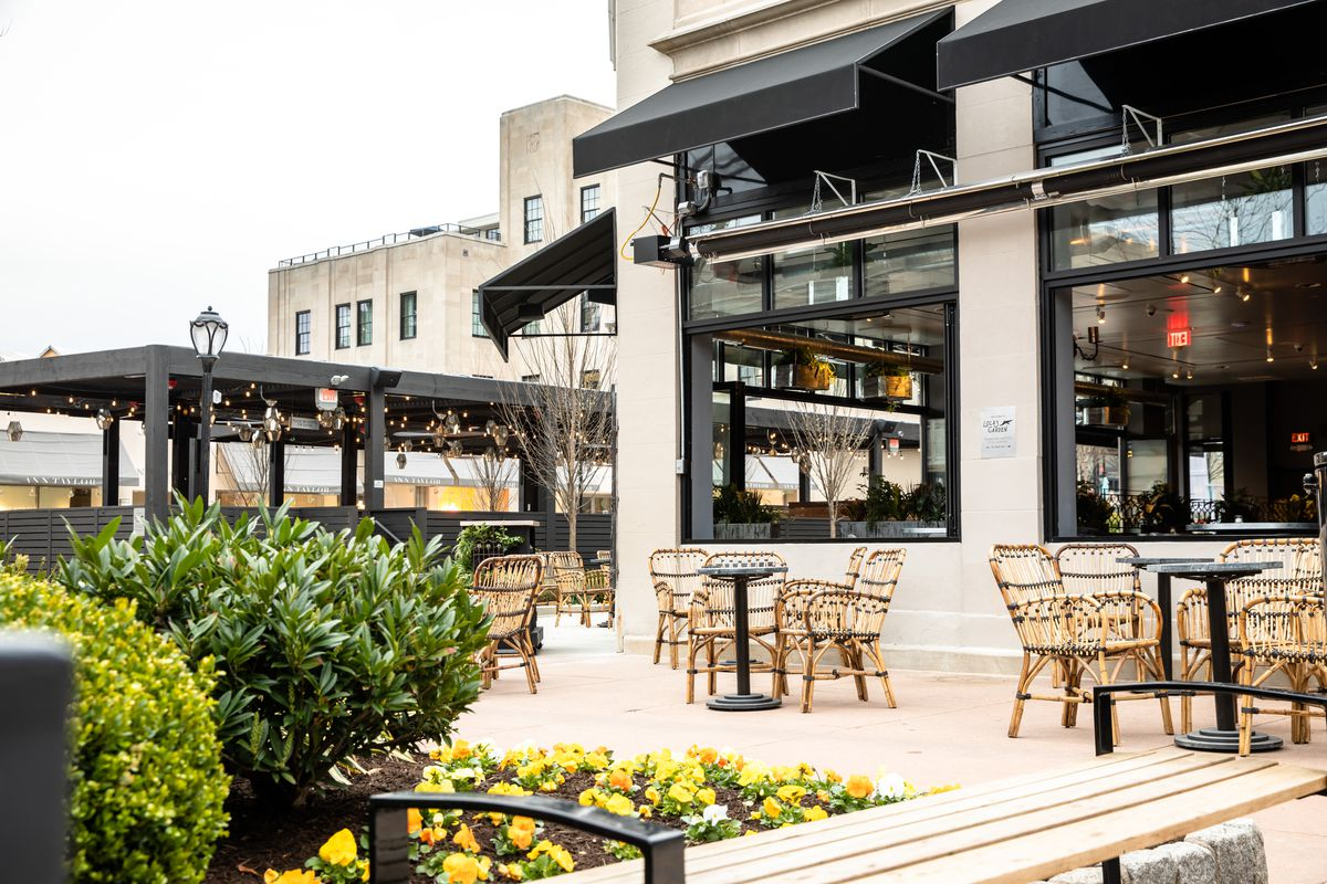 outside seating at lola's garden with black awnings and bistro chairs