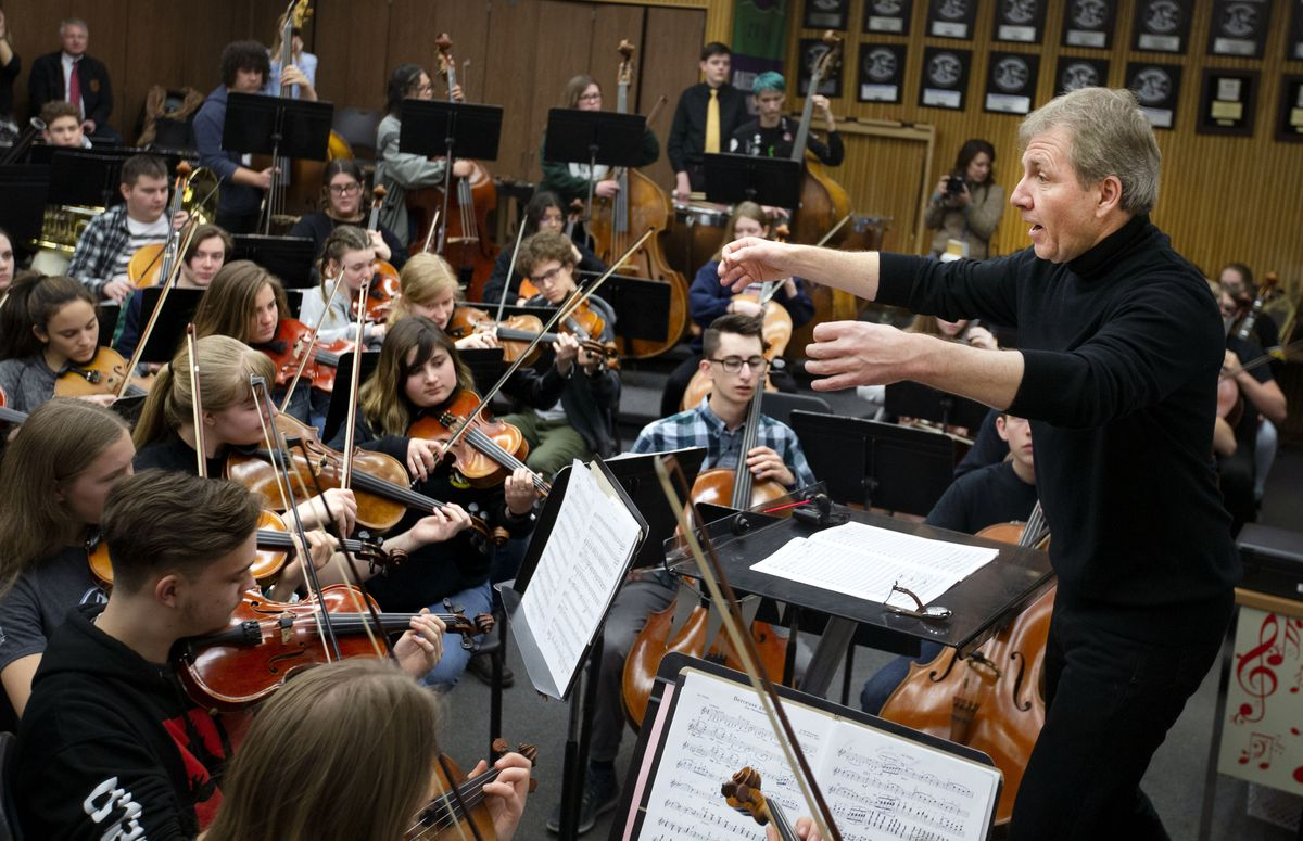 Music Director of the Utah Symphony Thierry Fischer directs the Cottonwood High School orchestra in Murray on Thursday, March 14, 2019.