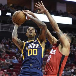 Utah Jazz guard Jordan Clarkson (00) shoots as Houston Rockets forward Thabo Sefolosha defends during the second half of an NBA basketball game, Sunday, Feb. 9, 2020, in Houston.