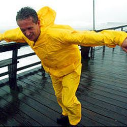 Scott Randolph of High Point, N.C., leans into the wind as he tries to walks in Atlantic Beach, N.C., Thursday during the full force of the storm. By evening, Isabel had weakened to a tropical storm.