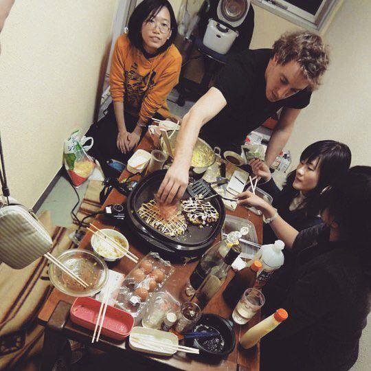 Ok Yaki owner Corban Irby serving students at Osaka University in Japan