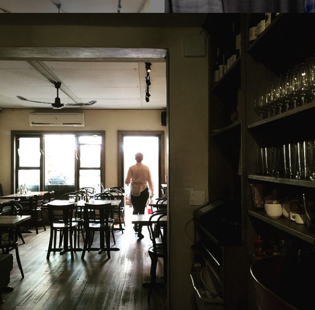 A server inside the wooden dining room of LIC Market