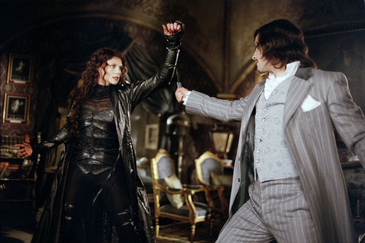 A man and a woman in the middle of a fight.
