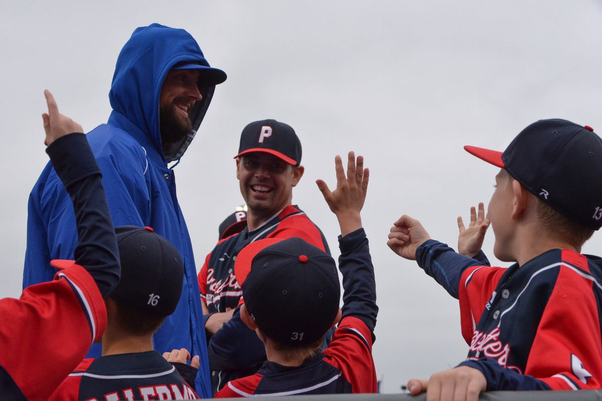 A hooded Luke Hochevar made some new friends on his day off in Omaha.