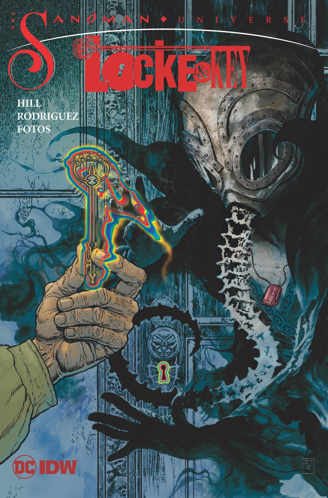 A hand holds an otherworldly key up to the kin gof Dreams on the cover of Locke & Key: Hell and Gone, from DC Comics and IDW Publishing.