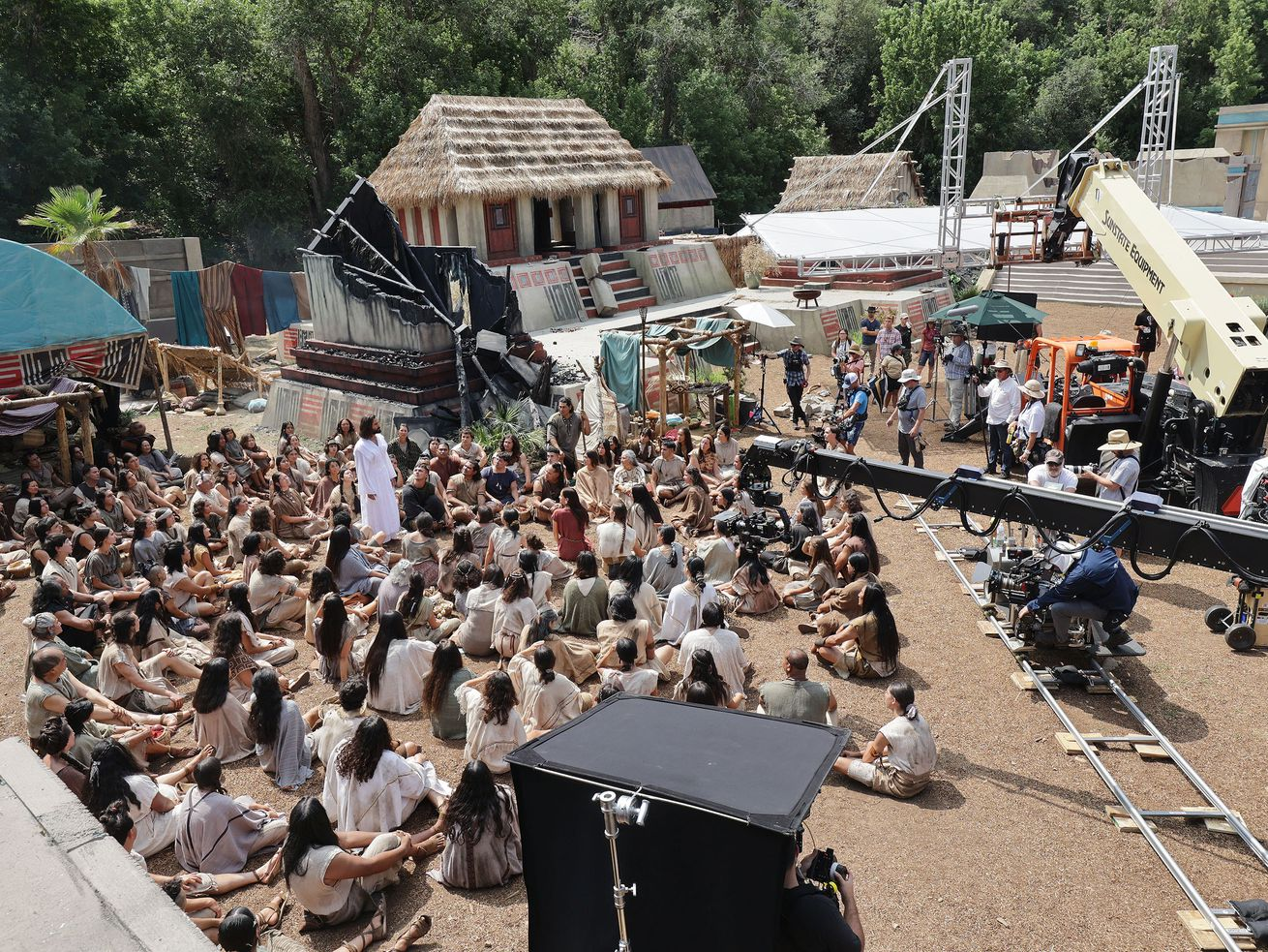 Cast and crew film a scene of the fourth season of the Book of Mormon videos.