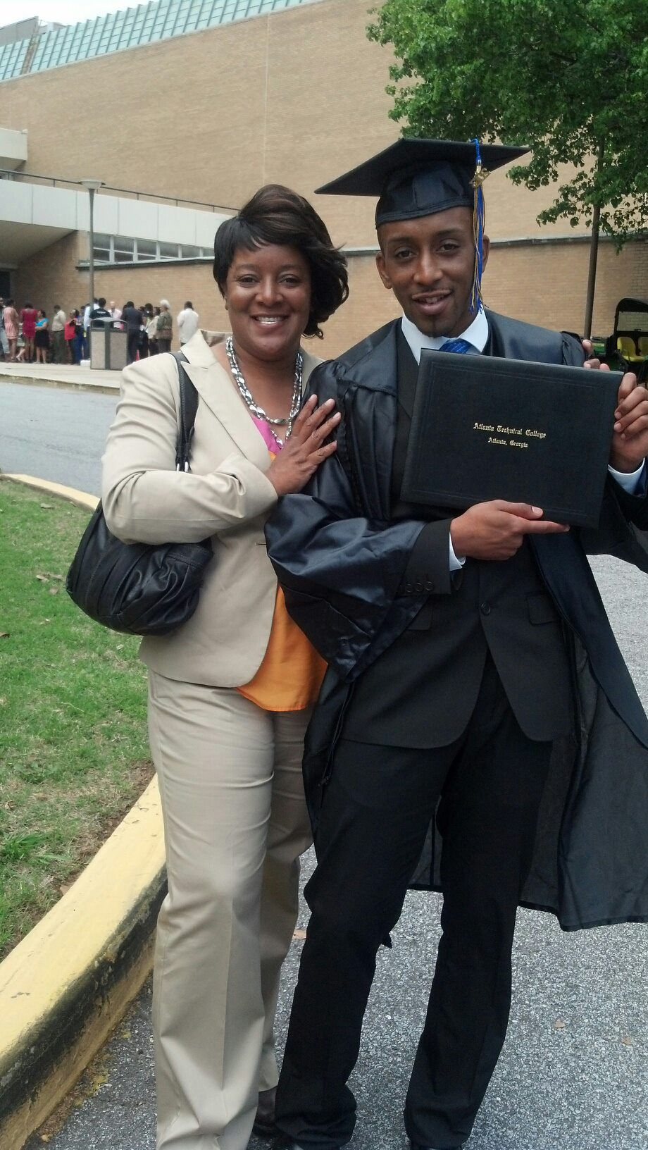 Ellen Trawick with her son at his graduation from Atlanta Technical College in 2013.