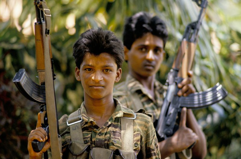 Tamil Tiger fighters in and around Jaffna in the north of Sri Lanka during their war against the Sri Lankan Army. All Tamil Tigers have a poison capsule around their necks to prevent them being captured alive.