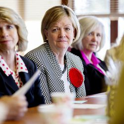Sister Bonnie L. Oscarson, general Young Women president of the LDS Church and other LDS leaders listen during a tour of the Avenues Children's Justice Center on Tuesday, April 28, 2015, in Salt Lake City.