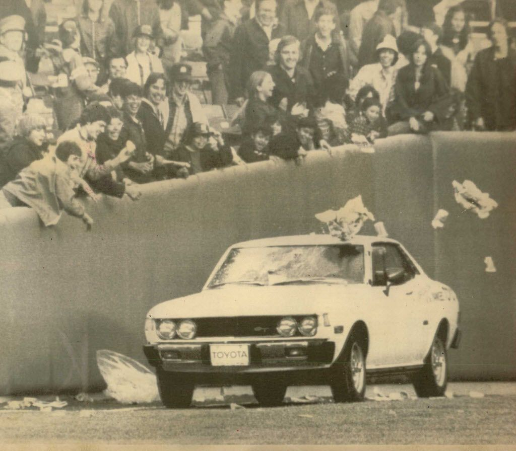 Fans shower refuse on car carrying Oakland A's relief pitcher Rollie Fingers from the bullpen of New York's Yankee stadium in the ninth inning of second game Sunday, Fingers, who turned in a sparkling relief job in the first game, lost the second of the d