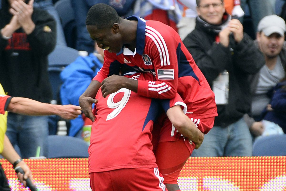 Mike Magee (9) celebrates his 85th minute goal with teammate Patrick Nyarko during the Chicago Fire's 2-0 win over DC United at Toyota Park on Sunday, June 2, 2013.