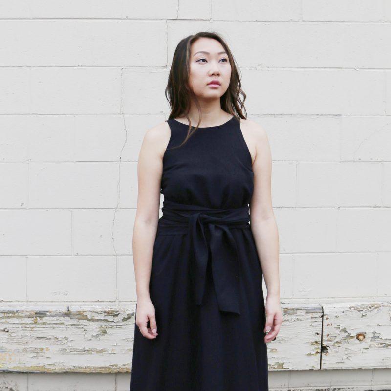 A model in a black wrap dress