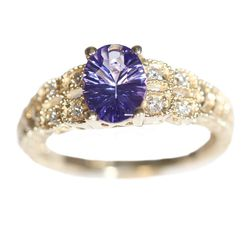 """14K yellow gold antique style ring with 8 accent round diamonds and a 1.09ct. oval fantasy cut tanzanite, $1,850 at <a href=""""http://www.safianrudolph.com/"""">Safian & Rudolph</a> on Jewelers' Row."""