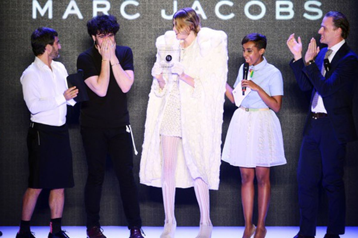 Spanish designer Leandro Cano accepts Designer for Tomorrow award from Marc Jacobs and white furry shoulder pads, via Getty