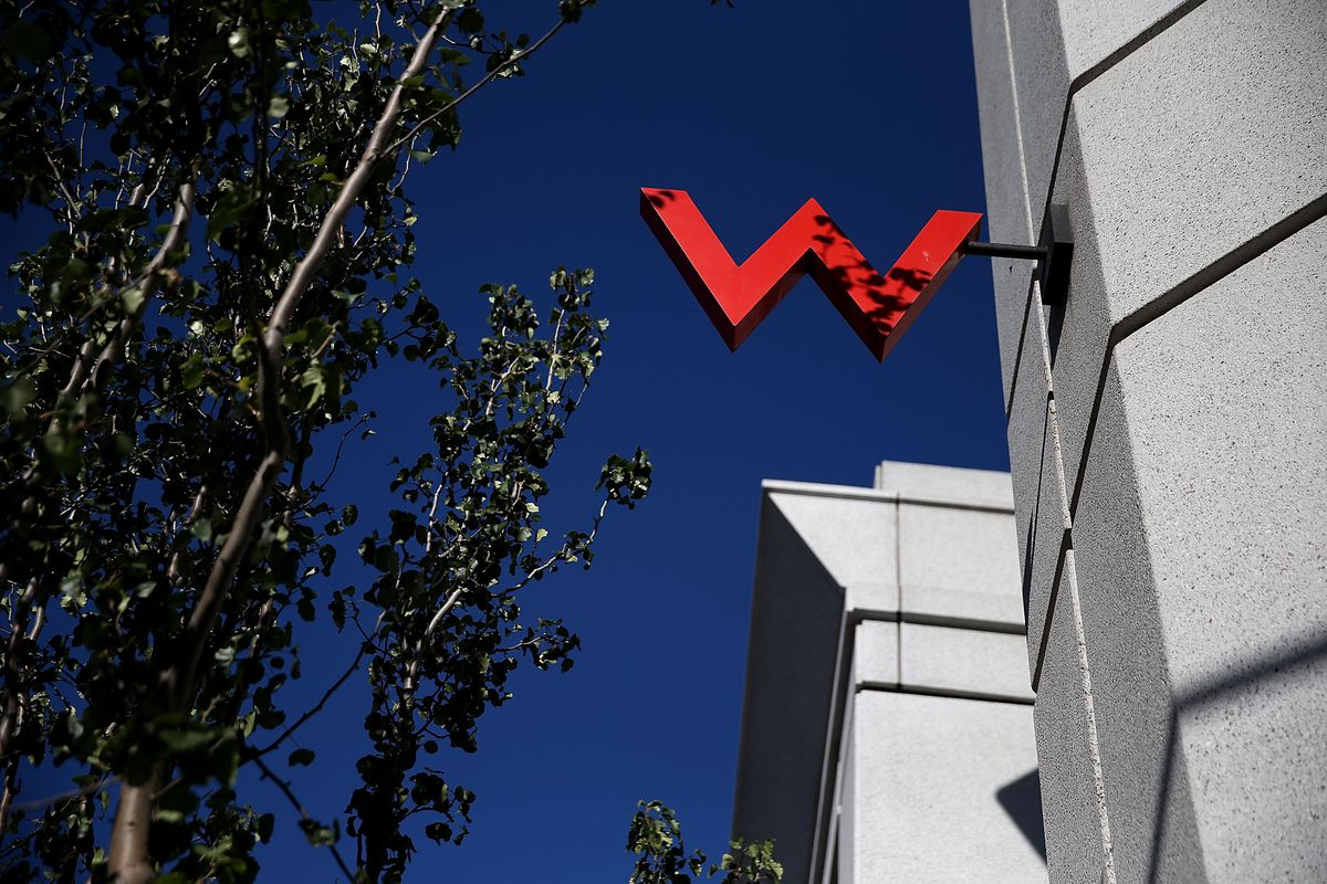 A giant red letter W attached to the side of a building.