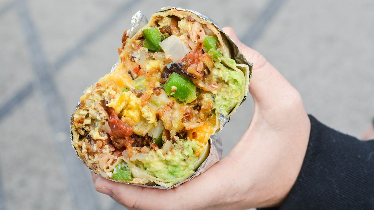 A cross-section of a breakfast burrito.