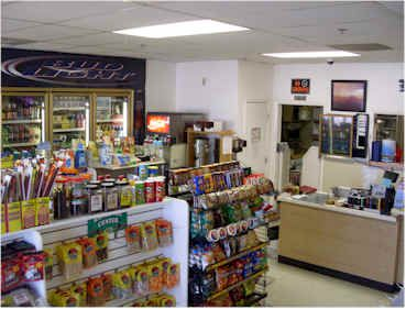 Interior of convenience store with snacks and drinks on display