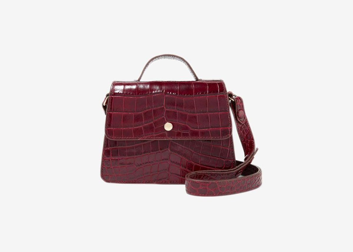 Maroon Croc Leather Crossbody Bag With Gold Circle Detailing And Top Handle Strap