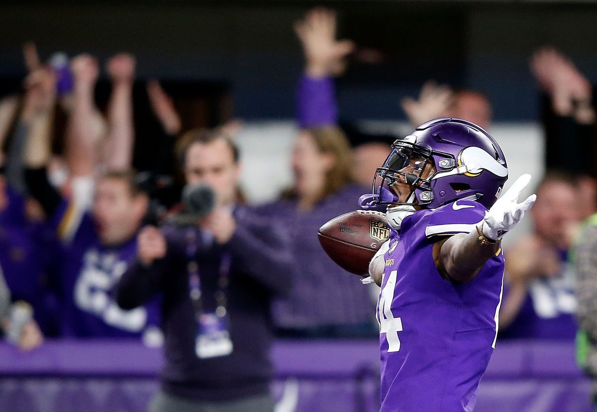 Wide receiver Stefon Diggs #14 of the Minnesota Vikings celebrates as he runs into the endzone for the game-winning touchdown.