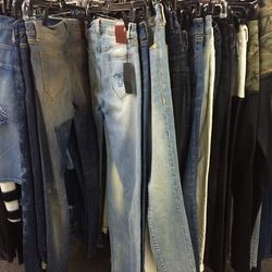 Rack of size 27 jeans