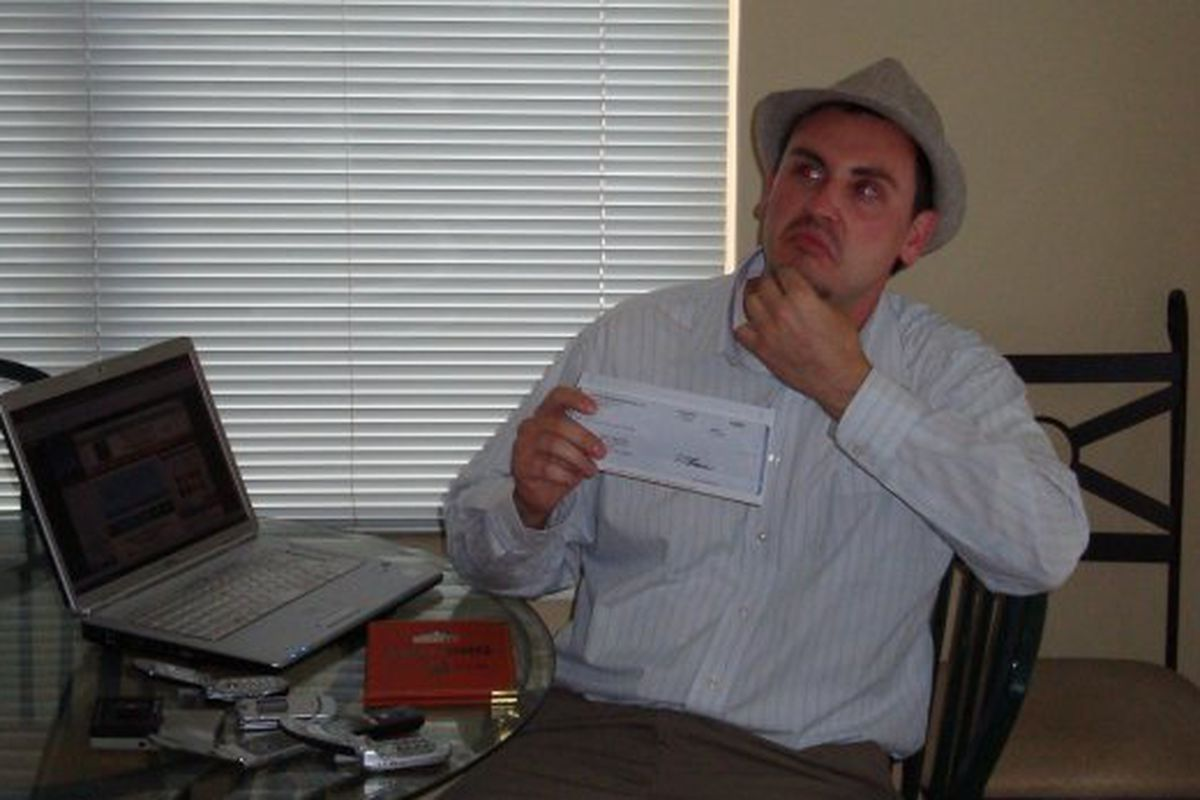Nate Timmons in his Metro apartment with his first blogger check in 2009.