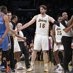 CORRECTS SPELLING OF NAME TO METTA, NOT META, AND TYPE OF FOUL TO FLAGRANT, NOT FRAGRANT - The Los Angeles Lakers Pau Gasol (16), of Spain, stands between Oklahoma City Thunder and other players after Lakers' Metta World Peace (15) was called for a double flagrant foul and ejected from the game in the first half of an NBA basketball game, Sunday, April 22, 2012, in Los Angeles.