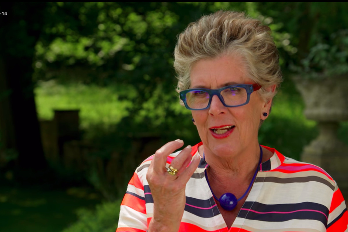 Prue Leith wearing a necklace with large blue ball and matching glasses.