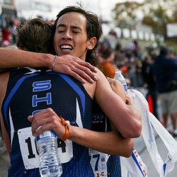 First-place finisher Carson Belnap and third-place finisher Josh Oblad, of Stansbury, hug after the 4A Boys State Cross-Country Championships at Highland High School in Salt Lake City on Wednesday, Oct. 23, 2019.