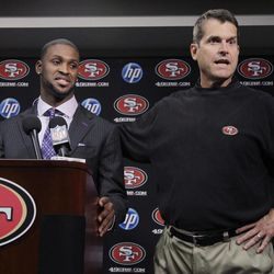 San Francisco 49ers first round draft pick  A.J. Jenkins, left, a wide receiver from Illinois, and head coach Jim Harbaugh, right, speak during an NFL football news conference at the team's headquarters in Santa Clara, Calif., Friday, April 27, 2012.