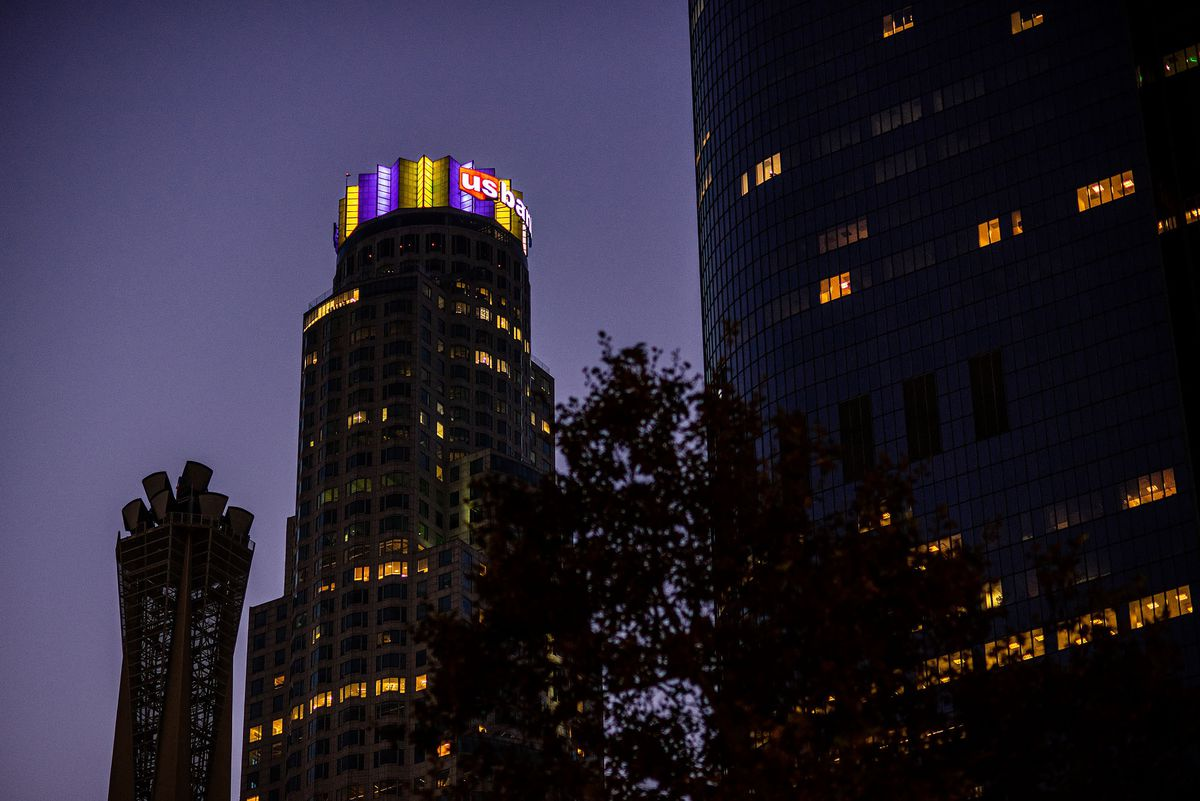 Darkened U.S. Bank Tower in Downtown LA with illuminated crown in Lakers colors.