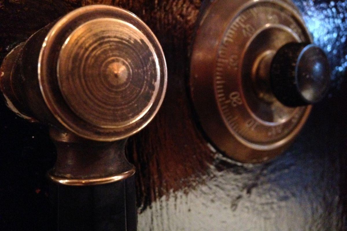 "Close-up of the combination lock on Dobra Tea's ""tea safe."""