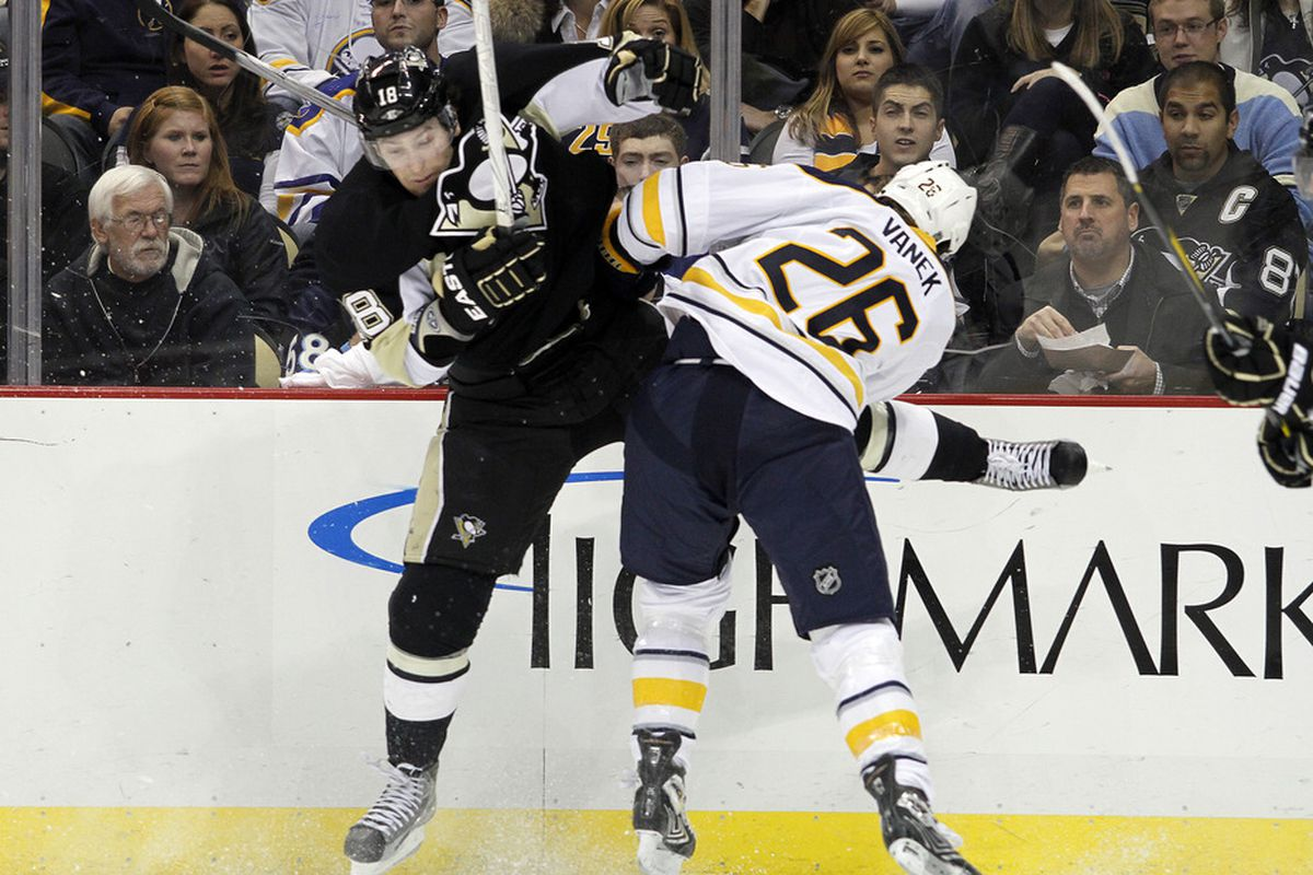 PITTSBURGH, PA - DECEMBER 17:  Thomas Vanek #26 of the Buffalo Sabres hits James Neal #18 of the Pittsburgh Penguins during the game at Consol Energy Center on December 17, 2011 in Pittsburgh, Pennsylvania.  (Photo by Justin K. Aller/Getty Images)