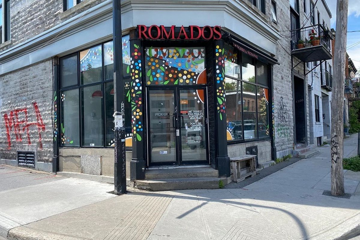 """storefront with red """"Romados"""" sign"""
