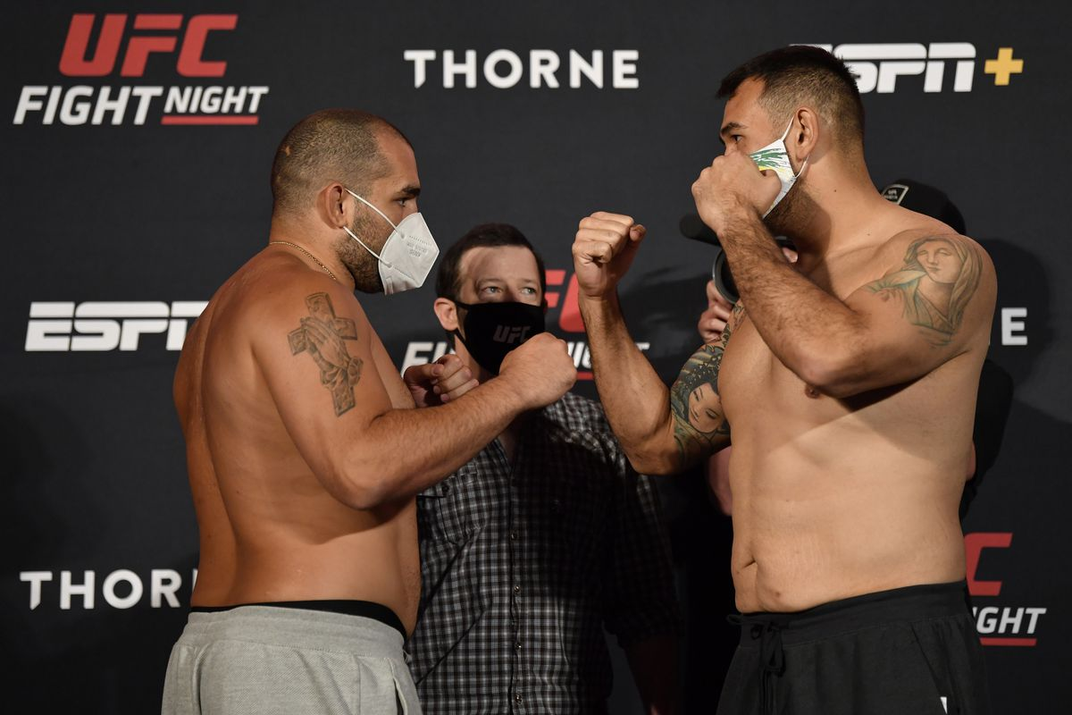 Opponents Blagoy Ivanov of Bulgaria and Augusto Sakai of Brazil face off during the UFC weigh-in at UFC APEX on May 29, 2020 in Las Vegas, Nevada.