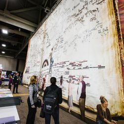 RootsTech attendees examine the many vendors at the Salt Palace in Salt Lake City on Friday, Feb. 10, 2017.