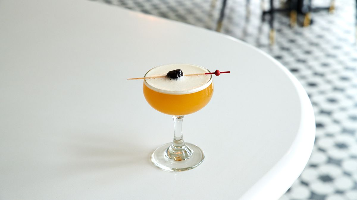 A picture of a Hotel Nacional daiquiri at Palomar, which arrives up, in a coupe glass, with a cherry