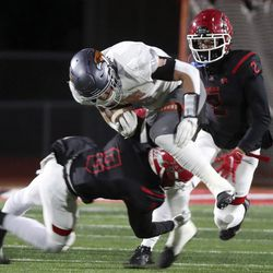 Skyridge's Teagen Calton gets tackled by American Fork's Jonathn Winder (8) and Fisher Ingersoll (2) during a varsity football game at American Fork High School in American Fork on Wednesday, Oct. 13, 2021. Skyridge won 42-22.