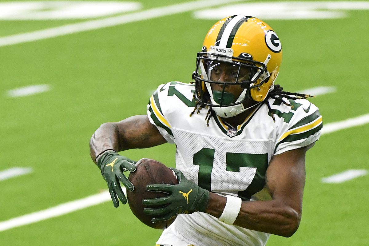 Davante Adams of the Green Bay Packers catches a 45-yard touchdown reception from Aaron Rodgers #12 against the Houston Texans during the third quarter at NRG Stadium on October 25, 2020 in Houston, Texas.