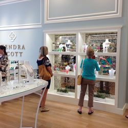 Business was brisk this morning, with many customers perusing the jewelry. The store actually opened yesterday—a day early.