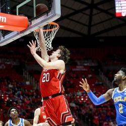 Utah Utes forward Mikael Jantunen (20) goes for the basket during the game against the UCLA Bruins at the Jon M. Huntsman Center in Salt Lake City on Thursday, Feb. 20, 2020.