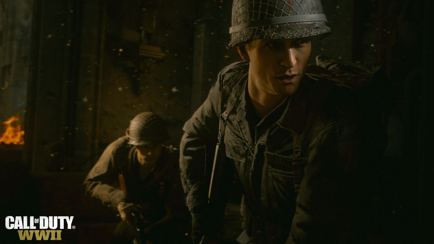 Call of Duty: WWII - soldiers look around the corner of a bunker