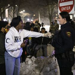 A protester argues with a Kenosha police officer near the Kenosha County Courthouse after District Attorney Michael Graveley announced that no charges will be filed against the Kenosha police officer who shot Jacob Blake, Tuesday night, Jan. 5, 2021. Jacob Blake, 29, was leaning into an SUV on Aug. 23, 2020, when police officer Rusten Sheskey opened fire, striking Blake in the back seven times.