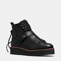 "Coach 'Urban Hiker' boot, <a href=""http://www.coach.com/online/handbags/Product-urban_hiker_boot-10551-10051-Q6550-en?cs=bkbk&catId=38999"">$395</a>"
